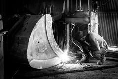 Man in the Iron Mask (_MootMoot_) Tags: monochrome blackwhite ouvrier work workman worker iron man black white bw chalumeau blowpipe mask cyprus chypre blast larnaca mari canon 70d 50mm welder soudeur light