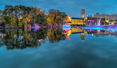 Revelling in the Reflections (tquist24) Tags: centurycenter hdr indiana nikon nikond5300 outdoor southbend stjosephriver bluehour clouds downtown evening geotagged lights longexposure reflection reflections river sculpture sky sunset tree trees water unitedstates