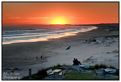 Watching the Sun Go Down (juliewilliams11) Tags: seaside shore landscape beach coast water waves ocean outdoor photoborder sunset sea sky clouds newsouthwales australia sand people