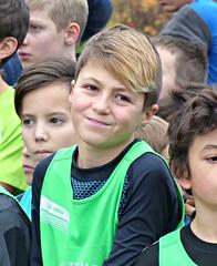A face in the crowd (Cavabienmerci) Tags: switzerland suisse schweiz run running race runner laufen lauf lufer course  pied coureur coureurs athlete athletes jungen boy boys kids kid garons sport sports