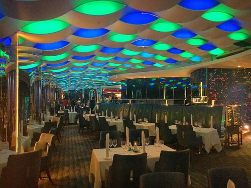 View from the other side, i guess the #restaurant for dinner 😊 #BurjAlArab #SkyviewBar #7StarHotel #Dubai #hotel #uae #green #blue #lights
