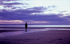 another purple place (Ron Layters) Tags: ironfigure silhouette anotherplace sculpture reflection tidalpool sunset antonygormley modernsculpture thefiguresarereplicasoftheartistsownbody crosbybeach figure iron beach seaside sea coast pool windfarm clouds crosby liverpool england cheshire unitedkingdom slidefilmthenscanned slide transparency fujichrome velvia leica r6 leicar6 ronlayters