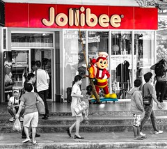 Jollibee (FotoGrazio) Tags: freetodownload asian composition mascot trademark photographersinsandiego fotograzio digitalphotography capture food waynegrazio streetphotography photographicart photographersincalifornia jolliebee freeimage fastfood waynesgrazio streetscene downloadforfree photoshoot selectivecolor pinoy philippines documentaryphotography red sandiegophotographer pacificislanders worldphotographer californiaphotographer artofphotography explore junkfood restaurant people filipino flickr internationalphotographers 500px freepicture photography socialdocumentary