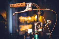 Bokeh Bike (thethomsn) Tags: bokeh bike bicycle handlebar curved night dark christmasseason fahrrad dof primelens sigma30mm14 glowing creamycolor street city germany availablelight thethomsn