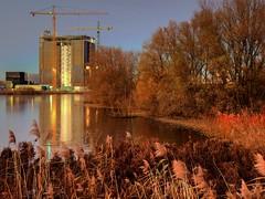 In between the Concrete (Skylark92) Tags: nederland netherlands holland amsterdam oost water lake meer science park sunset evening avond zonsondergang hdr autumn herfst east