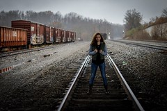 Chilly. (croleyy70) Tags: tennesseee biblebelt kentucky photographer photography paid free photosession photoshoot captures instagram followme love curly hair portraits portrait foreground background lighting composure zoom prime lens 50mm canonrebelt6i canonrebel canon traincar grunge metal posing woman female girl armygreen green olive fierce model gameoftones tone film mood moody dreary storm rain bokeh track traintrack trains train