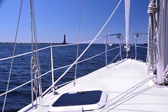 Leaving Port Muskegon . . . (Dr. Farnsworth) Tags: blue summer sky water lines mi sailboat lakemichigan porthole mast biglake lifelines pierheads august2013