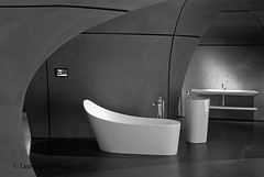 RocaGallery 28 E W 065 BW (laurencemackman) Tags: lighting motion london glass station architecture buildings concrete bathroom lights chelsea gallery exterior geometry contemporary interior railway fluid spanish elevation curved roca zahahadid futuristicarchitecture londonboroughofhammersmithandfulham zahahadidarchitects insituconcrete imperialwharf townmeadroad builtwork rocagallery rocagallerylondon norththamesgasworks