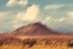 Lone Hill (Joseph Maddon) Tags: arizona cloud mountain southwest nature landscape outdoors photography desert hiking grain az slowshutter grainy sonoran cloudscape originalfilter uploaded:by=flickrmobile flickriosapp:filter=original