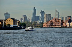 City Down the River (A-Lister Photography) Tags: city light sky sun sunlight mist london water horizontal misty skyline architecture sunrise landscape boats boat warm cityscape view skyscrapers bright horizon citylife sunny bluesky landmark icon business commercial ripples positive sunlit iconic financial gherkin rotherhithe modernarchitecture wapping banking walkietalkie cityoflondon finance cheesegrater watery londonicon cityphotography iconiclondon mistylandscape leadenhallbuilding adamlister nikond5100 alisterphotography