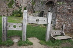 Stocks and Pillory (lazy south's travels) Tags: castle heritage history feet island islands wooden hands stocks torture jersey punishment channel gorey restraint humiliation restrained humiliated pillory
