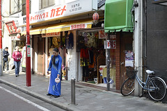 Morning Housekeeping (Igor Voller) Tags: china street morning blue woman water girl bike japan shop hair town log chinatown dress chinese sunny sidewalk  yokohama pouring wateringpot