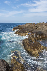 Rocky island (Ivanov Andrey) Tags: sea island ocean coast stone sky beach water air bay beauty blue cape cliff cloud explore harbour horizon journey landscape nature vista shore walk travel wave weather white wind tide lowtide tenerife spain