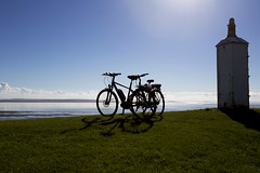 End of the ride (Blue Rock Fox) Tags: bicycles bikes view shadows bristolchannel severnestuary gwent newport wales southwales coast sea beach shore water sun sunlight lowsun afternoonsun leisure recreation beauty beautiful backlit backlight intothesun