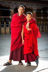 Bhutanese Monks (whitworth images) Tags: young asian portrait spiritual scarlet devout buddhist himalaya dzong person himalayas two robe bhutan boy red religion religious man ringpongdzong people parodzong travel monastery friends maroon male crimson monks asia fabric bhutanese paro parodzongkhag