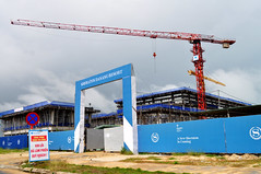 It's coming... (Roving I) Tags: cranes construction buildingsites sheraton resorts architecture fences signs gateways entrances tourism travel danang developments vietnam