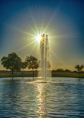 Sunrise At The Fountain (playful_i) Tags: arizona casagrande villagolake villagopark desert lake park sunrise water