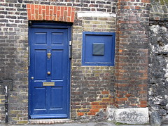 Blue Door in a brick wall, Westminster, London