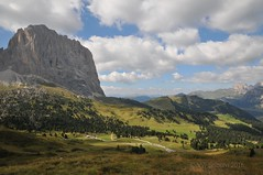 The roads through Sella Pass (Vee living life to the full) Tags: italy leger travel touring holiday landscape rock pass sella towers mountain nikond300 heathaze view road sky cloud blue cross sassolungo