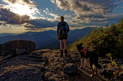 Afternoon views from South Dix (Mountain Visions) Tags: pentax k5 smcpentaxda15mmf4edallimited adirondacks adirondack adk dixmountain southdixmountain hiking adventure clouds sky saluki collie woman ruffwear camelbak sunset afternoon starburst newyork newyorkstate 518 traildog mountains foreverwild wilderness nature blueline