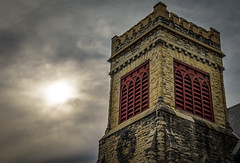Church Bell Tower (mraarondouglas) Tags: kenosha wi wisconsin downtown chicago il illinois milwaukee lake michigan church bell tower bells red brick cream old branches branch tree hdr cluds cloudy sky ominous sun sunlight peeking through clouds cloud color colors colorful detail comanding image photo photography photograph canon canon1585 camera cameras rebel t5 1200d low light long exposure