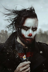 The Clown (Megan Glc Photographe) Tags: clown makeup halloween dark scary flower particles magical light fantasy photomanipulation manipulation photoshop photoshoot portrait man horror daisy blood hair wind red