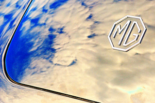 Clouds reflected in an MG `A` tail