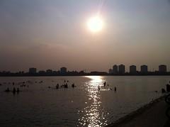 Inner city swim (Ben.Fowler.Photography) Tags: sun lake swimming vietnam tay local ho hanoi hotay