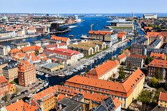 Aerial View on Roofs and Canals of Copenhagen, Denmark (ansharphoto) Tags: street new old city travel blue red sea sky urban house building tourism water beautiful architecture facade copenhagen relax landscape denmark boats coast boat town canal opera colorful europe theater cityscape view walk famous capital sightseeing culture bank tourist baltic aerial medieval roofs shore danish sail recreation sight yachts scandinavia