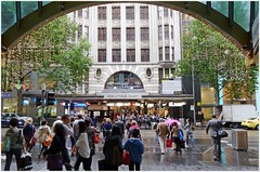 "From ""Australia on Collins"" (The Australia Arcade) across Collins Street to Centre Way Arcade, Melbourne. (fotograf1v2) Tags: wetweather centralcity collinsstreet christmaslights theaustraliaarcade pedestriancrossing people centrewayarcade arch architecture melbourne australia formeraustraliaoncollins stcollinslane"