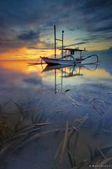 Morning Reflections (Made Suwita Photography) Tags: morning sky bali reflection beach sunrise indonesia jukung pantaikarang