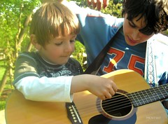 helping each other (mknt367 (Panda)) Tags: boy k playground kids t outside guitar 2008 guitarlessons