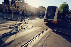 Chasing the light ([~Bryan~]) Tags: street city morning light milan bicycle cycling track milano transport tram chasing chasingthelight
