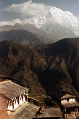 21-427 (ndpa / s. lundeen, archivist) Tags: nepal houses sky house mountain mountains color building film clouds rural 35mm buildings landscape village 21 nick hill peak hills mountainside nepalese peaks 1970s hillside 1972 himalayas snowcovered nepali dewolf mountainvillage ruralvillage annapurnasouth nickdewolf photographbynickdewolf ruralnepal reel21 hillyregion