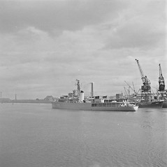 A German Cruiser leaving Dublin after a courtesy visit! (National Library of Ireland on The Commons) Tags: jamespodea odeaphotographiccollection nationallibraryofireland germannavy courtesyvisit dublinport peace grafspee f215 northwallquay dublin westgermany ringsend cranes port hipper f214 commanderhcollmann commanderphartwig frigate mvmurell cadets trainingship reception salute