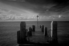 Out to sea (Sundornvic) Tags: bw blackwhite sea seaside posts water sky ir pentaxart
