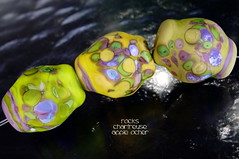Rocks Chartreuse Apple Ocher (Laura Blanck Openstudio) Tags: openstudio openstudiobeads glass murano handmade lampwork beads bead set jewelry whimsical funky odd frit organic abstract earthy asymmetric colorful multicolor rocks nuggets pebbles stones art fine arts artisan artist made usa published winner show festival big lavender lilac purple violet grape matte etched opaque frosted glow ocher green chartreuse lime parrot apple yellow