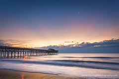 Sunrise at Myrtle Beach (ratulm) Tags: pier myrtle beach sunrise ocean clouds moon sky colors south carolina water landscape seaside shore coast