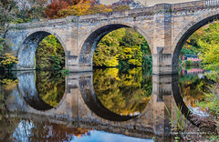 Prebends Bridge Autumnal Reflections (robinta) Tags: colour color autumn fall bridge building arch architecture stone landmark historic old ancient water riverwear river landscape pentax sigma18200mmhsmc ks1 durham seasonal trees leaves nature structure england ngc theunforgettablepictures