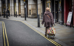 Stripes On The Street (DobingDesign) Tags: streetphotography london stripes shoppingtrolley londonstreets people walking lines roadmarkings crossingtheroad streetsigns coventgarden citylife woman beret pavement browncoat road doubleyellowlines