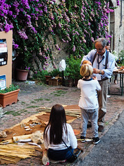 Mutual exchange (bulgit) Tags: children old man knowledge show exchange mutual wood flowers natural siena tuscany italy