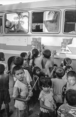 Laos : children and circus #4 (foto_morgana) Tags: analogphotography analogefotografie asia blackwhitephotography bus childhood children circus ilfordxp2 indochina jeugd jeune jeunesse jong juventud laos lightroom nikoncoolscan outdoor people photographienoiretblanc photographieanalogue travelexperience vuescan young youth zwartwitfotografie