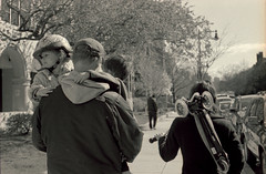 Carrying (dtanist) Tags: street family film boston kids analog children 50mm bay back dad pentax kodak massachusetts smc beacon ricoh carrying bw400cn pentaxm xrm