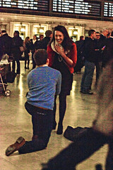 The Proposal (Slow Little Photo) Tags: nyc newyorkcity winter newyork love america 50mm engagement couple amor manhattan candid grain january romance relationship amour surprise proposal grandcentral grandcentralterminal 2014 engagementphotography marriageproposal engagedcouple canonrebel2