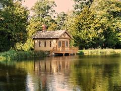 Elizabethan Boathouse (saxonfenken) Tags: reflection pond boathouse belton latesun 8118 thechallengefactory beltonboathouse pregamesweepwinner gamesweepwinner 8118lake