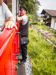 Pertisau July 2014 (Roger Hanuk) Tags: groupofpeople achenseebahn austria carriage jenbach man men outside pertisau railway seebergspitze ticketcollector train maurach tyrol