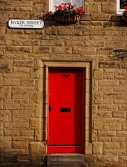 Baker Street (heinrich_511) Tags: stirling scotland unitedkingdom red wall texture flowers light door 78 baker street gm5 35100mm