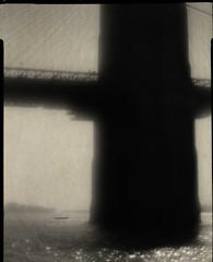Small boat under the Brooklyn Bridge (Giovanni Savino Photography) Tags: pictorialism lessismore brooklyn brooklynbridge boat smallboat papernegative 4x5camera largeformatphotography reflections water newyorkcity bridge magneticart giovannisavino