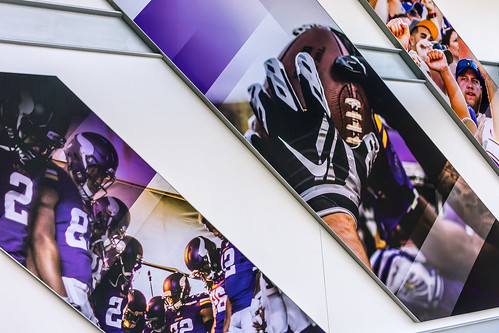 Wall with Pictures of current Minnesota Vikings Team in Upper Deck Stairway - Color