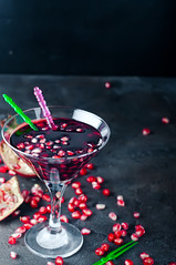 Delicious pomegranate cocktail (lyule4ik) Tags: cocktail drink pomegranate juice holiday xmas party background fruit summer leaf alcohol refreshment liqueur glass sweet red beverage fresh black gin cold condensation grenadine bar vodka copyspace refreshing tasty caribbean crushed reflection rum alcoholic vacation isolated slice berry delicious tropical cube hurricane studio ice dark long dew closeup ripe